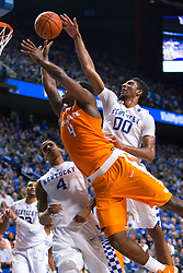 Kentucky forward Marcus Lee, right, and guard Charles Matthews contest a shot by Tennessee forward Armani Moore in the first half. .<br /> <br /> The University of Kentucky hosted the University of Tennessee, Thursday, Feb. 18, 2016 at Rupp Arena in Lexington .