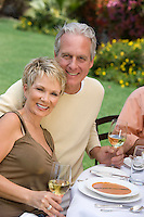Couple drinking wine outdoors, portrait