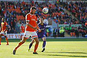 Ryan Edwards of Blackpool clears from John Marquis of Portsmouth during the EFL Sky Bet League 1 match between Blackpool and Portsmouth at Bloomfield Road, Blackpool, England on 31 August 2019.