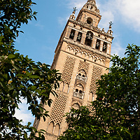 Giralda is the name of a former minaret that was converted to a bell tower for the Cathedral of Seville. Actually it is only the name of the statue on top of the tower.