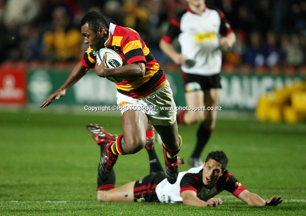 Waikato wing Sitiveni Sivivatu leaves Stephen Brett behind as he runs in a try during the Air New Zealand Cup week 3 rugby union match between Waikato and Canterbury at Waikato Stadium in Hamilton, New Zealand on Friday 11 August 2006. Waikato won the match 36 - 22. Photo: Kevin Booth/PHOTOSPORT<br />