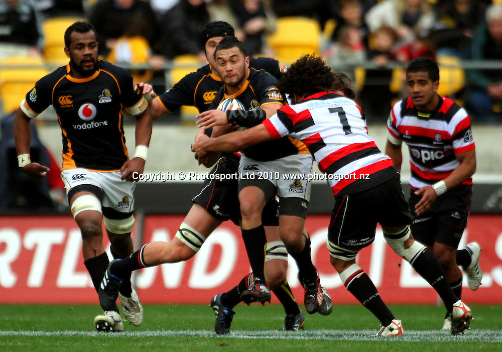 Wellington first five Fa'atonu Fili is tackled by Pepa Koloamatangi. ITM Cup - Wellington Lions v Counties-Manukau Steelers at Westpac Stadium, Wellington, New Zealand on Sunday, 8 August 2010. Photo: Dave Lintott/PHOTOSPORT