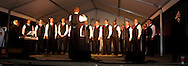 The Dayton Gay Men's Chorus performs on the main stage during the Grande Illumination & Dayton Children's Parade Spectacular in Lights which begins the 39th Annual Dayton Holiday Festival in Courthouse Square in downtown Dayton, Friday, November 25, 2011.