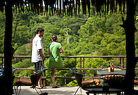 A couple enjoy the view from the deck of Restaurant Brisa Azul at Lapa Rios Ecolodge, Osa Peninsula, Costa Rica