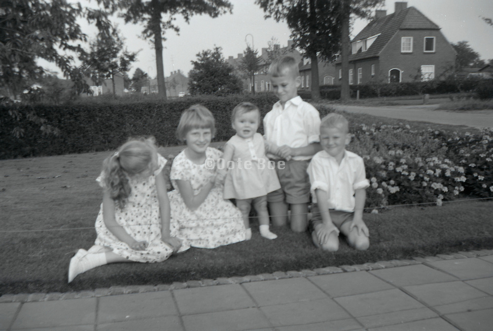 Girls and boys posing for a family picture. 1960s Holland