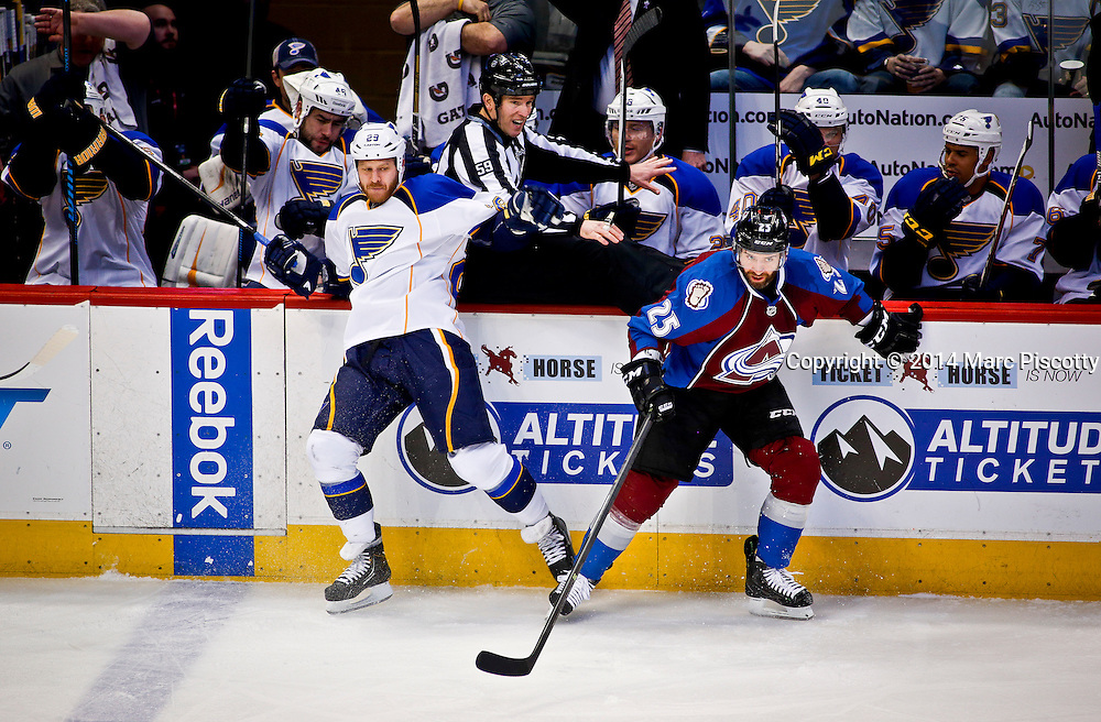 SHOT 3/8/14 2:06:07 PM - The Colorado Avalanche's Maxime Talbot #25 gets hit along the boards by the St. Louis Blues' Steve Ott #29 during their regular season Western Conference game at the Pepsi Center in Denver, Co. The Blues won the game 2-1.<br /> (Photo by Marc Piscotty / &copy; 2014)