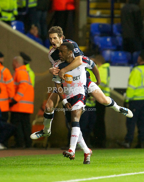 BOLTON, ENGLAND - Saturday, January 21, 2011: Bolton Wanderers' Nigel Reo-Coker celebrates scoring the second goal against Liverpool with Sam Ricketts during the Premiership match at the Reebok Stadium. (Pic by David Rawcliffe/Propaganda)
