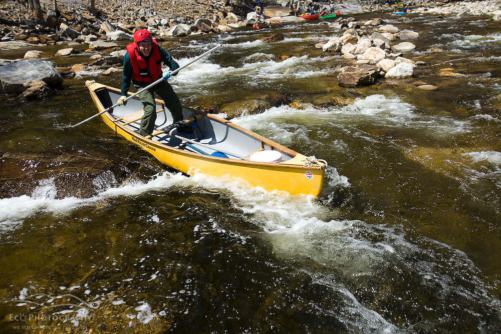 Poling a canoe on the Ashuelot River in Surry New Hampshire USA