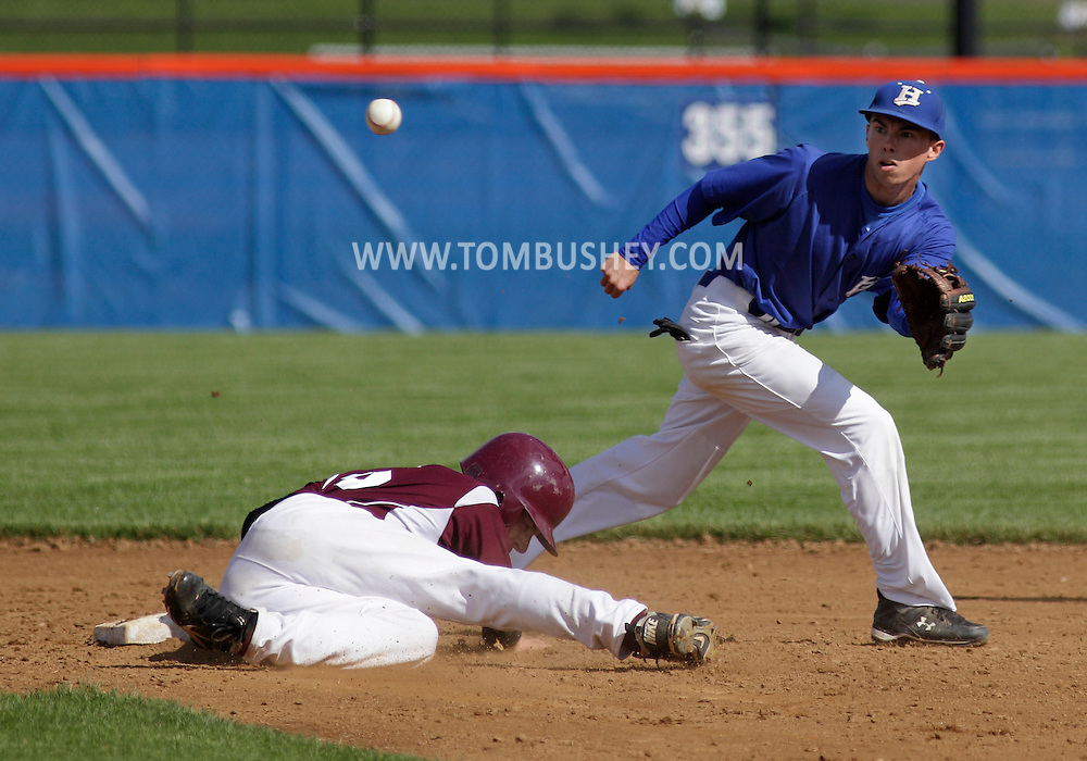 Kingston's Jesse Uttendorfer slides into second base as Kyle Lewis of Horseheads reaches for the late throw during a state Class AA quarterfinal baseball game at SUNY New Paltz on Tuesday, June 5, 2012.