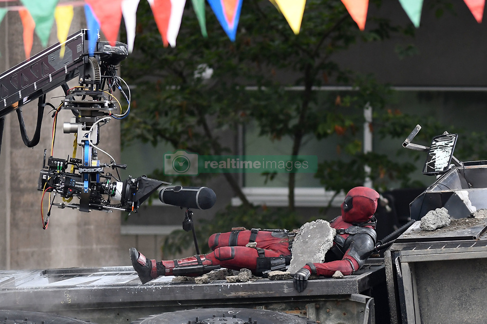 Ryan Reynolds returns to filming on set of Deadpool 2 in Vancouver following accident on set. Deadpool 2 resumed filming 48 hours after the accident on set which caused the life of a stunt double. Ryan was seen arriving on set before putting on the suit and filming scenes on top of a flipped truck in downtown Vancouver. 16 Aug 2017 Pictured: Ryan Reynolds. Photo credit: Atlantic Images/ MEGA TheMegaAgency.com +1 888 505 6342