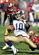 SAN FRANCISCO - SEPTEMBER 17:  Niners defensive end Bryant Young #97 grabs quarterback Marc Bulger #10 of the St. Louis Rams from behind while tacking on one of six sacks by the San Francisco 49ers at Monster Park on September 17, 2006 in San Francisco, California. The Niners defeated the Rams 20-13. ©Paul Anthony Spinelli *** Local Caption *** Bryant Young;Marc Bulger