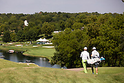 Bio Kim, left, and his caddy walk down the 18th fairway during the 2012 Price Cutter Charity Championship at Highland Springs Country Club on August 9, 2012 in Springfield, Missouri. (David Welker/www.TurfImages.com).