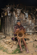 Chang Naga making basket<br /> Chang Naga headhunting Tribe<br /> Tuensang district<br /> Nagaland,  ne India