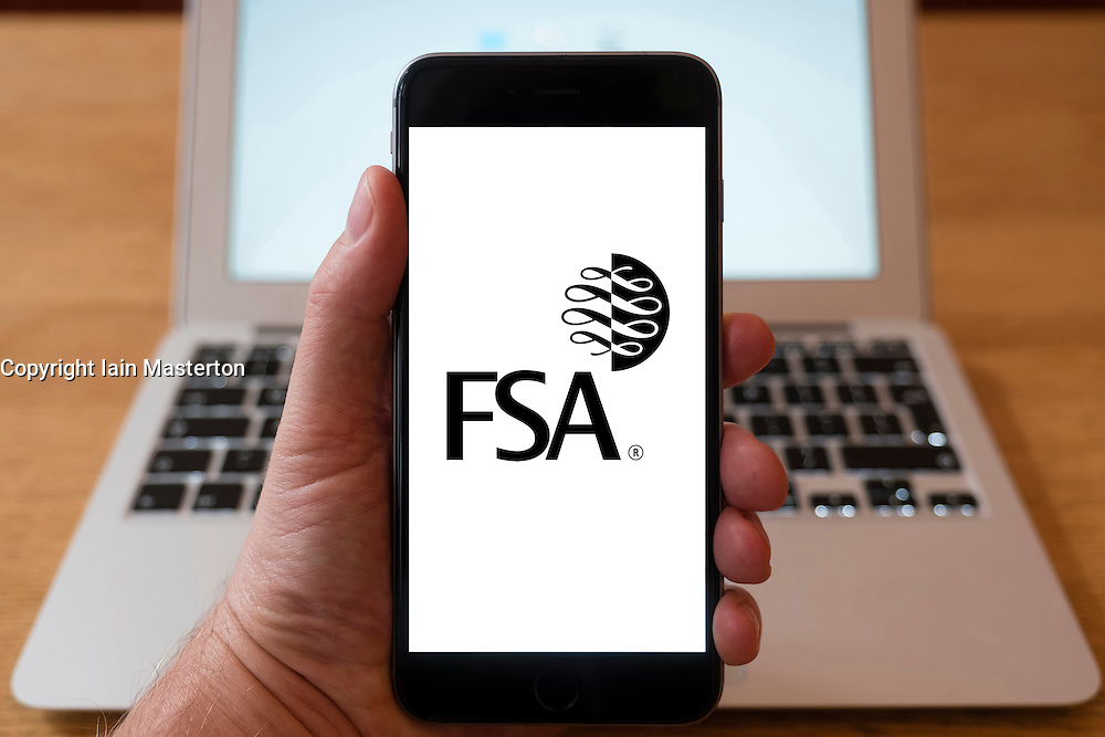 Using iPhone smartphone to display logo of FSA, Financial Services Authority