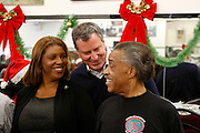 New York, NY- December 25- l to r: New York City Councilwoman Leticia James, New York City Public Advocate Bill de Blasio and Rev. Al Sharpton at the Rev. Al Sharpton and National Action Network Feeding of the Hungry on Christmas Day & Toy Giveaway at the Annual NAN Event held at the NAN's House of Justice on December 25, 2011 in Harlem, New York City. Photo Credit: Terrence Jennings