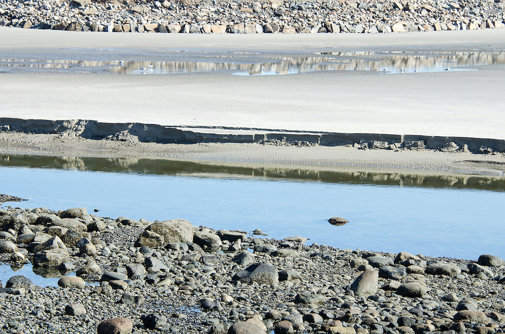 Layers of sand and rocks left behind by the receding tide, Ogunquit, Maine.