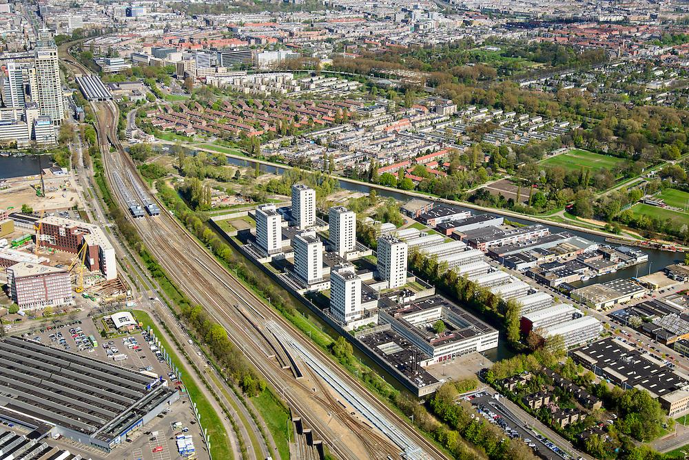 Nederland, Noord-Holland, Amsterdam, 09-04-2014; Omval, Spaklerweg met rechts Bijlmerbajes. Penitentiaire Inrichting (PI) Amsterdam Over-Amstel met Huis van Bewaring (HvB) en  Penitentiair Psychiatrisch Centrum (PPC). Rechts in de achtergrond de Duivendrechtsekade, links Amstelstation.<br /> Six towers of Amsterdam prison.<br /> luchtfoto (toeslag op standard tarieven);<br /> aerial photo (additional fee required);<br /> copyright foto/photo Siebe Swart