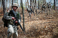 Apr, 10, 2011, Camp Edwards, Massachusetts - Cadets patrol as part of a training exercise. Photo by ©Lathan Goumas.