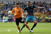 Sheffield Wednesday defender Vincent Sasso holds up Wolverhampton Wanderers striker Joe Mason during the Sky Bet Championship match between Wolverhampton Wanderers and Sheffield Wednesday at Molineux, Wolverhampton, England on 7 May 2016. Photo by Alan Franklin.