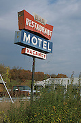 Weathered motel and restaurant sign