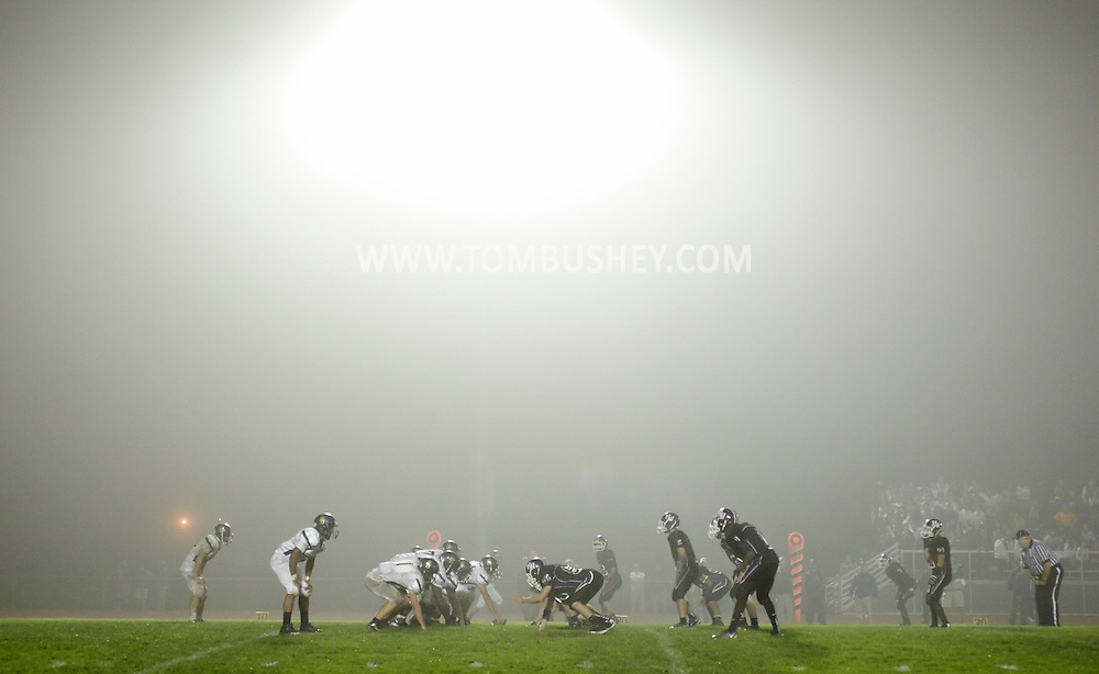 Pine Bush, at left, and Monroe-Woodbury football players line up during a game in foggy Central Valley on Friday, Sept. 28, 2012.