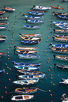 ca. 2000, Vernazza, Italy --- Rowboats in a Riviera Marina --- Image by © Owen Franken/CORBIS