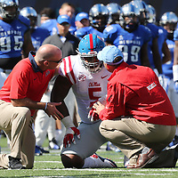Lauren Wood | Buy at photos.djournal.com<br /> Ole Miss defensive tackle Robert Nkemdiche is checked out by trainers after being hit during Saturday's game at Memphis. Nkemdiche was ruled to have a concussion.
