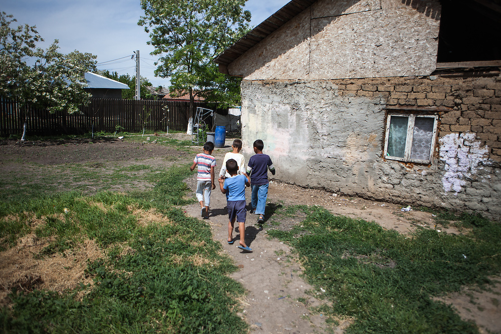 A group of boys walking in the Roma area of Frumusani.