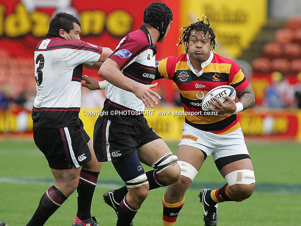 Waikato's Sione Lauaki fending of Mike Noble during the Air NZ Cup rugby match between Waikato and North Harbour played at Waikato Stadium, Hamilton, New Zealand on Sunday 1 October  2006.    Photo: Brett O'Callaghan/PHOTOSPORT