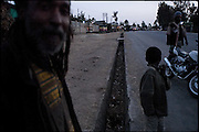 """The main road of Shashemene, the village of about 300 km from Addis Ababa, during the first hours of sunset. In this part of the city lies most of the Jamaican Rastafarian, who manages small activities. Shashemene, south Ethiopia, on saturday, March 22 2008.....""""Shashamene or Shashemene (ethiopian name), located in the Oromia Region of Ethiopia, is """"the place"""", the ancestral homeland. For the whole Rastafarians repatriation to Africa or to Zion or to the Promise Land is the first goal. Rastas assert that """"Mount Zion"""" is a place promised by Jah and they  claim themselves to represent the real Children of Israel in modern times. During the last years of the 40's, Emperor Haile Selassie I, considerated from that movement incarnation of God, donated 500 acres of his private land to members and other settlers from Jamaica including other parts of the Caribbean..The Rastafarian settlement in Shashamane was recently reported to exceed two hundred families. In January 2007 it organized an exhibition and a bazaar in the city. It was also reported recently prior to the Ethiopian Millennium that various pro-Ethiopian World Federation groups, consisting of indigenious Ethiopians and Rastafarians, have given support to one of many five year plans proposed for sustainable development of Shashamene, Ethiopia."""""""