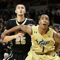 USF Bulls Forward Ron Anderson Jr. (1) blocks out Central Florida forward A.J. Tyler (25) during the NCAA basketball game against the UCF Knights  at the UCF Arena on November 18, 2010 in Orlando, Florida. UCF won the game 65-59. (AP Photo/Alex Menendez)