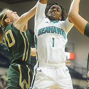 UNCW's Naqaiyyah Teague shoots over William and Mary's Kyla Kerstetter Sunday January 4, 2015 at Trask Coliseum on the campus of UNCW. (Jason A. Frizzelle)