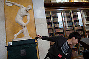 Visitors copy the pose of Discoblus, the 2nd century AD Roman copy of Myron's 450-440BC original sculpture, on 28th February 2017, in London, England. It was discovered, minus its original head, in 1791 in Hadrian's villa at Tivoli, near Rome.
