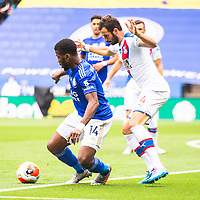LEICESTER, ENGLAND - JULY 04: Kelechi Iheanacho of Leicester City holds the ball up from Luka Milivojevic of Crystal Palace during the Premier League match between Leicester City and Crystal Palace at The King Power Stadium on July 4, 2020 in Leicester, United Kingdom. Football Stadiums around Europe remain empty due to the Coronavirus Pandemic as Government social distancing laws prohibit fans inside venues resulting in all fixtures being played behind closed doors. (Photo by MB Media)