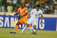 Saphir Taider  of Algeria shields the ball against Serey Die  of Ivory Coast during their AFCON 2015 Quarter Finals Match on February 1 2015 at Estadio de Malabo Equatorial Guinea. Photo/Mohammed Amin/www.pic-centre.com (Equatorial Guinea)