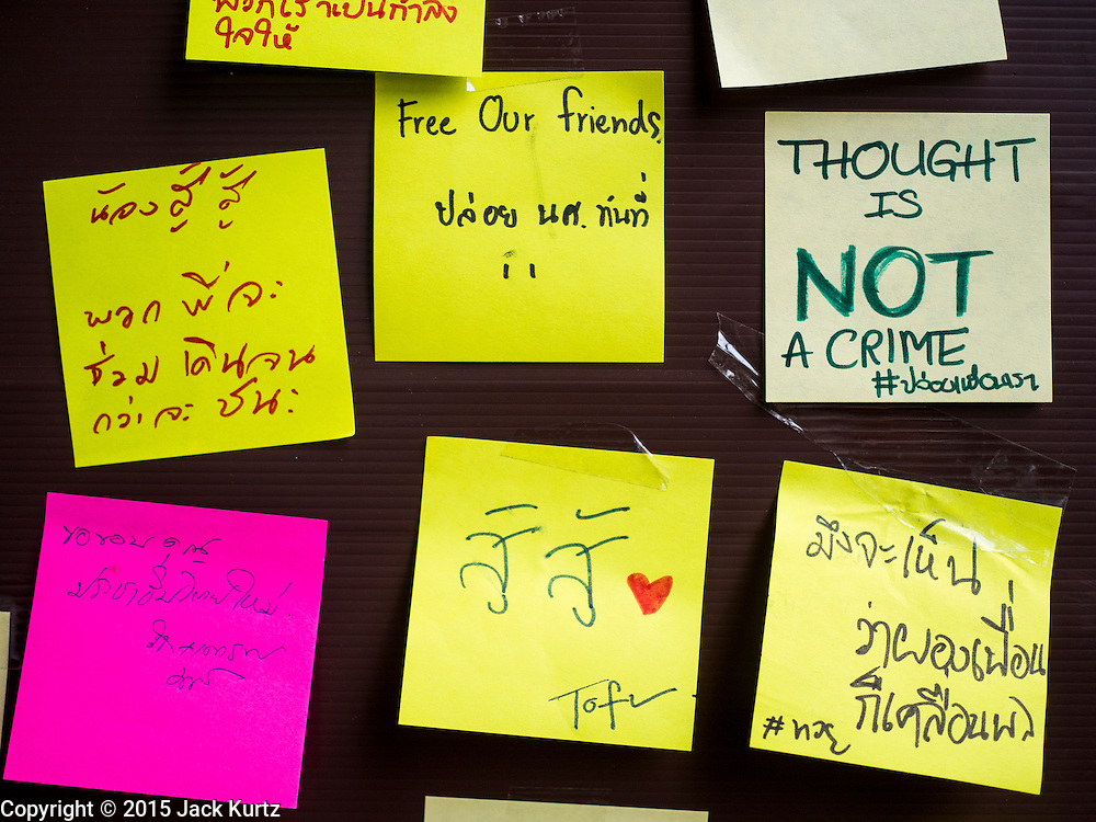 "06 JULY 2015 - BANGKOK, THAILAND:  A wall covered in ""Post It"" notes related to the arrest of 14 students for violating orders related to political assembly. More than 100 people gathered at Thammasat University in Bangkok Monday to show support for 14 students arrested two weeks ago. The students were arrested for violating orders against political assembly. They face criminal trial in military courts. The students' supporters are putting up ""Post It"" notes around Bangkok and college campuses up country calling for the students' release.     PHOTO BY JACK KURTZ"