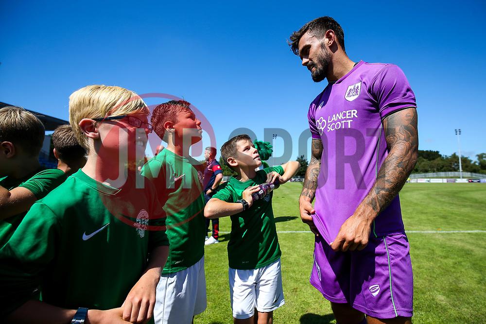 Marlon Pack of Bristol City meets young Guernsey mascots - Rogan/JMP - 08/07/2017 - Footes Lane - Guernsey - Guernsey FC v Bristol City - Pre-season Friendly.