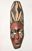 Wooden African ceremonial mask on white background