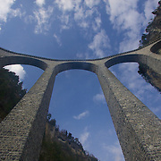 Underneath the 213ft (65m) high Landwasser Viaduct in Fillisur. Built in 1901-2 It is a timeless design that complements the surrounding cliff landscape.