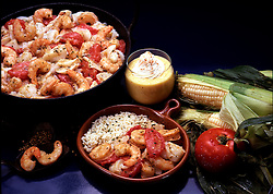 Still life Brazilian Brazil sweet corn pudding fish and shrimp stew food Fishermans stew White fish filets whole kernel corn South American recipe