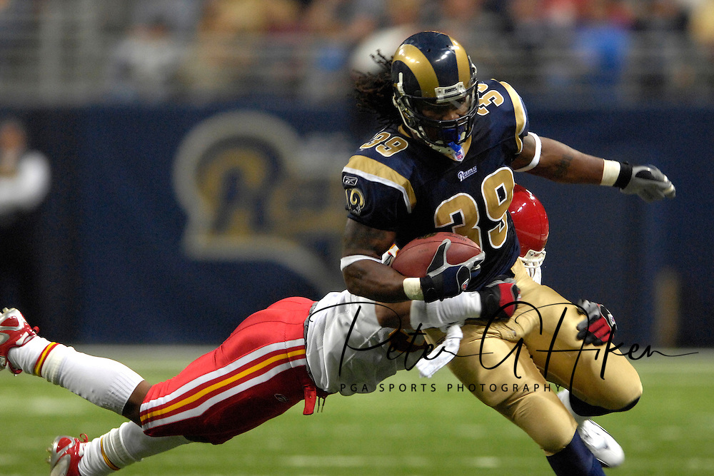 St. Louis Rams running back Steven Jackson (39) is caught from behind by Kansas City linebacker Kris Griffin in the second half at the Edward Jones Dome in St. Louis, Missouri, November 5, 2006.  The Chiefs beat the Rams 31-17.<br />