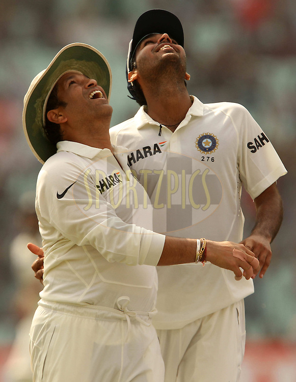 Sachin Tendulkar and Bhuvneshwar Kumar of India celebrate the wicket of Kieran Powell of West Indies during day one of the first test match between India and The West Indies held at The Eden Gardens Stadium in Kolkata, India on the 6th November 2013<br /> <br /> Photo by: Ron Gaunt - BCCI - SPORTZPICS