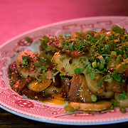 Chef Danny Bowien's restaurant, Mission Chinese, is photographed at its New York City location on the Lower East Side of Manhattan on Tuesday, July 31, 2012 in New York, NY. This is the Thrice Cooked Bacon dish. .