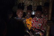Pokot girls sit inside a hut during their circumcision ceremony.