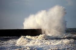 © Licensed to London News Pictures. 10/12/2014. Aberystwyth, Wales, UK. Gale force winds and huge waves hit the Welsh coastline. Photo credit: Graham M. Lawrence/LNP