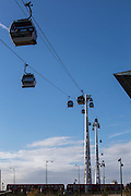 Emirates Air Line cable cars travel across the River Thames between Greenwich Peninsula and the Royal Docks in London, England, United Kingdom.  The Air Line opened in 2012  and was built by Doppelmayr with sponsorship from the airline Emirates. A Transport for London Docklands light railway train passes underneath.  (photo by Andrew Aitchison / In pictures via Getty Images)