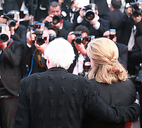 Actress Catherine Deneuve and Director John Boorman with photographers at Sils Maria gala screening red carpet at the 67th Cannes Film Festival France. Friday 23rd May 2014 in Cannes Film Festival, France.