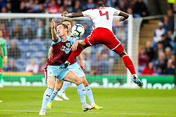 Ashley Barnes of Burnley challenges Mady Camara of Olympiakos - Mandatory by-line: Robbie Stephenson/JMP - 30/08/2018 - FOOTBALL - Turf Moor - Burnley, England - Burnley v Olympiakos - UEFA Europa League Play-offs second leg