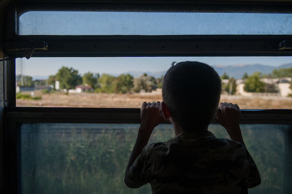 Sunday 13th of September 2015. A migrant boy looks out of the train window as the train of refugees and migrants passes through the Republic of Macedonia.