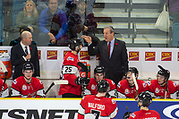 KAMLOOPS, CANADA - NOVEMBER 5: Team WHL head coach Tim Hunter stands on the bench during second period against the Team Russia on November 5, 2018 at Sandman Centre in Kamloops, British Columbia, Canada.  (Photo by Marissa Baecker/Shoot the Breeze)